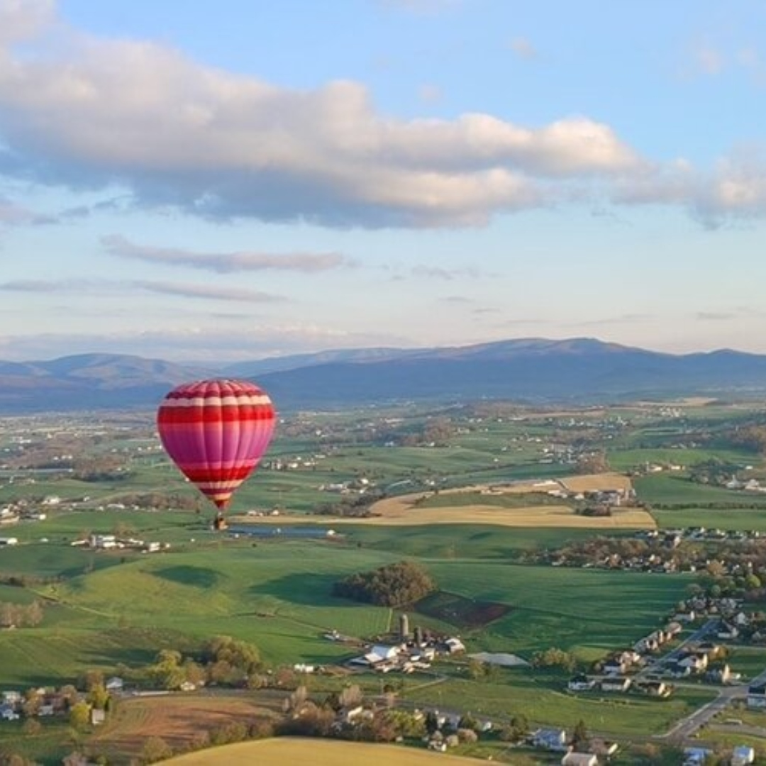 hot air balloon piloted by Adventure Time Ballooning flying over Jefferson County Tennessee in East Tennessee