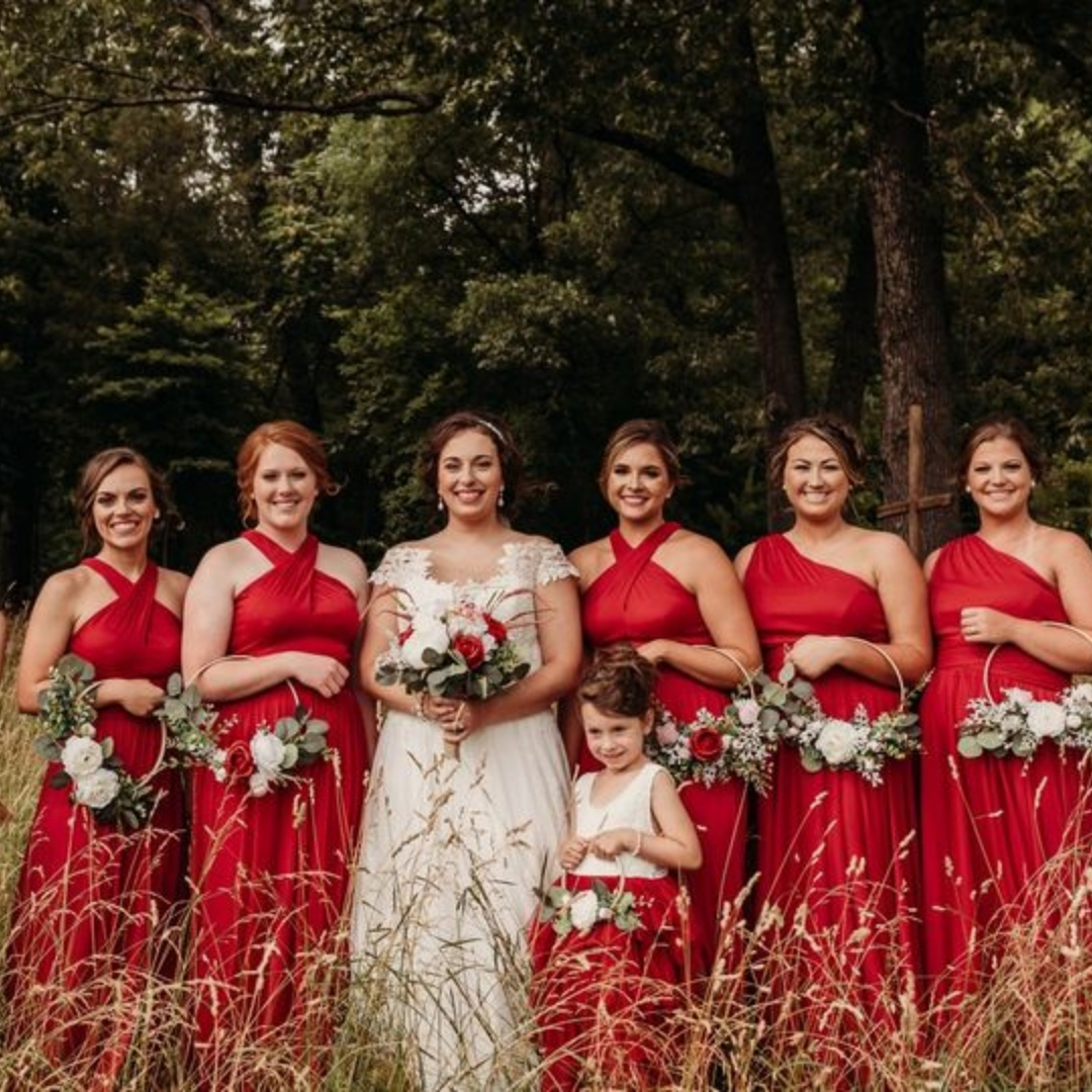 bride with her bridesmaids standing in a field at colley farm