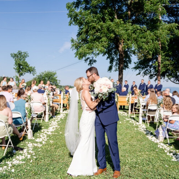 newly wed couple at the end of the aisle at east tennessee special event venue haun family farm