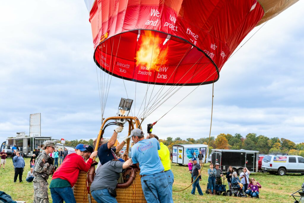 hot air balloon blowing up at lakeside of the smokies balloonfest